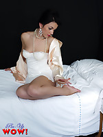 Mysterious brunette Bryoni-Kate Williams in satin nightrobe and corset knows how to tease