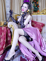 Glam babe in a fancy evening gown completed with black gloves and stockings