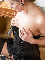 Slinky in oriental dress, Skye strips to reveal a black satin basque,  holding sexy black fully fashioned nylons!