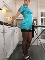 Ironing in a mandarin dress and black stockings